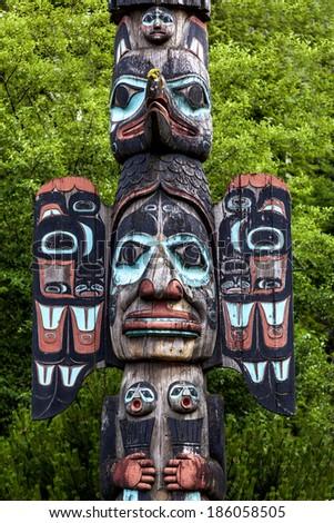 Carved totem pole in Ketchikan, Alaska - stock photo