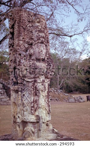 Carved upright stela, an unusual feature of the ancient Mayan city of Copan, Honduras