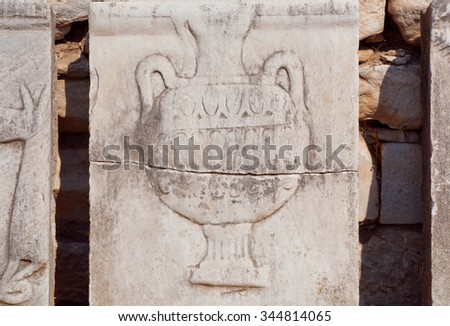 Carved vase for wine from relief of Greek-Roman empire time, Ephesus city. Ancient city Ephesus founded on 10th century BC.   - stock photo