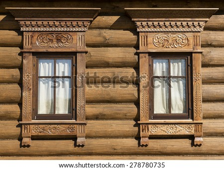 carved wood trim Russian hut - stock photo