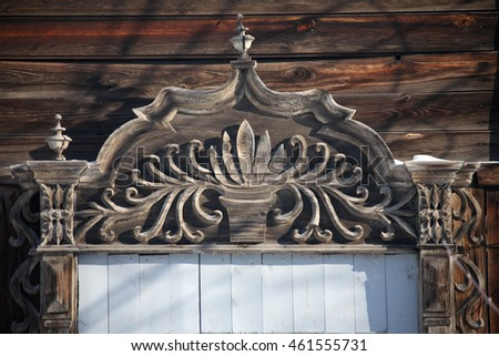 Carved wooden decorative lace decoration windows. The old wooden building. City Tomsk, Siberia, Russia.