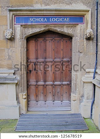 Carved wooden door at entrance to School of Logic, Bodleian Library, Oxford, United Kingdom. - stock photo