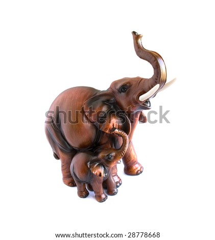 carved wooden elephant and it's child isolated - stock photo