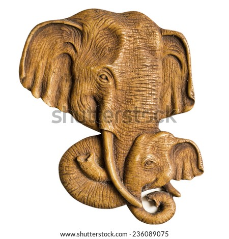 Carved wooden elephant on white background - stock photo