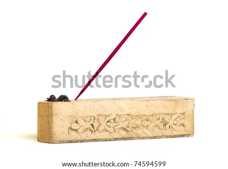 Carved wooden incense burner with joss stick isolated on white. - stock photo