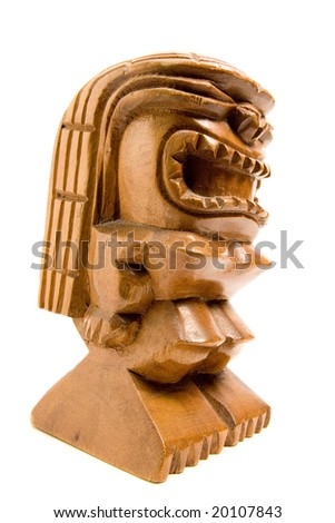 carved wooden tiki, isolated on white - stock photo