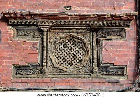 Carved wooden window details on the Royal Palace. Durbar square, Patan, Kathmandu, Nepal - stock photo