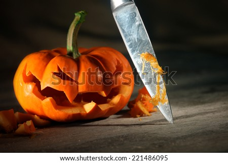 Carving a Halloween jack o' lantern - stock photo