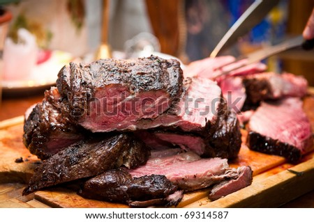 Carving beef roast - stock photo