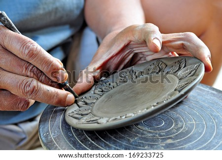 Carving clay for make earthenware. - stock photo