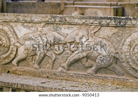 Carving of elephants fighting decorating the walls of the Rani-ki Baoli step-well in Bundi, India