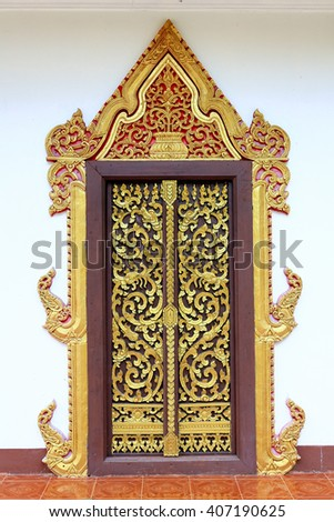 Carving of Thai Temple door in golden color. on white background.  - stock photo