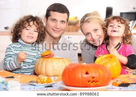 Carving the Halloween pumpkin - stock photo