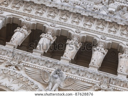 Carvings above main entrance to the Basilica of Notre Dame de Fourviere in Lyon city, France - stock photo