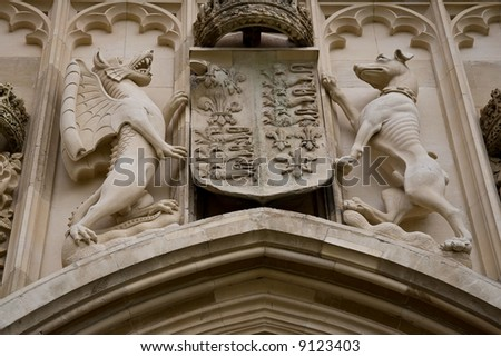 Carvings above the arch at Kings College in Cambridge - stock photo