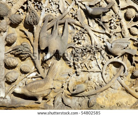 Carvings in concrete of birds in the trees on the Bethesda Terrace in Central Park, New York City; in horizontal orientation - stock photo