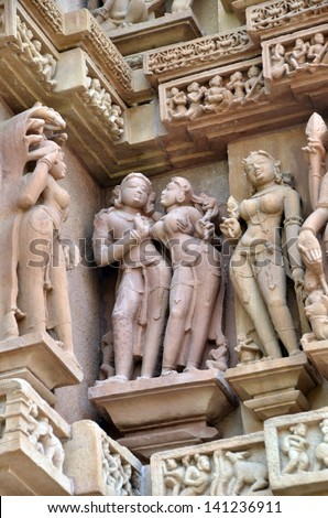 Carvings on Temple walls at Khajuraho, AD 930-950 - stock photo