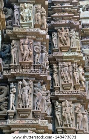 Carvings on temple walls at Khajuraho AD 930-950 - stock photo