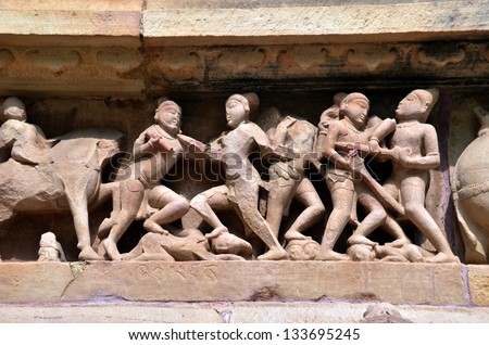 Carvings on Temple walls at Khajuraho, AD 930-950 UNESCO heritage site, - stock photo