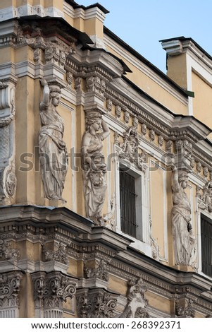 Caryatids on the facade of an old house in St. Petersburg, Russia - stock photo