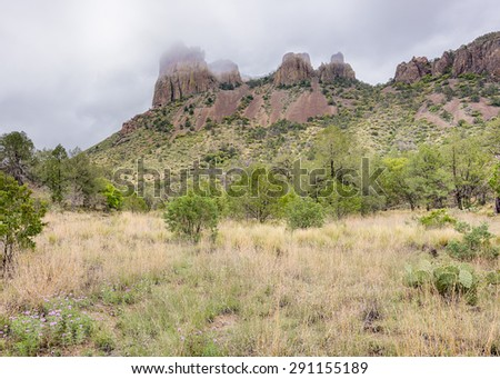 Casa Grande in the Mist, on the Pinnacles / Emory Peak Trail in the Chisos Mountains Basin area of Big Bend National Park, Texas. - stock photo