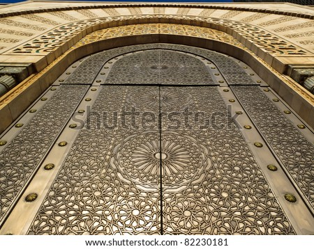 Casablanca, Morocco:  Detail of ornate exterior of brass door of Hassan II Mosque