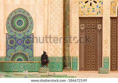 Casablanca, Morocco: Ornate exterior brass door of Hassan II Mosque in Casablanca, Morocco. - stock photo