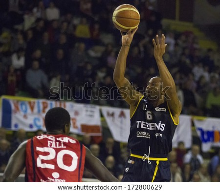 CASALE MONFERRATO, ITALY, JANUARY 19 - Jerry Smith of Tezenis Verona shoots the ball in the basketball game for DNA Gold League between Novipiu Casale and Tezenis Verona. Casale won 73-64 - stock photo