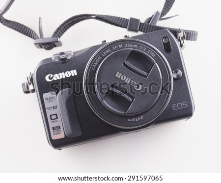 CASALE MONFERRATO, June 25, 2015: Canon Eos M over white background. Model M is the first mirrorless camera for Canon, one of leading hi tech brand worldwide - stock photo