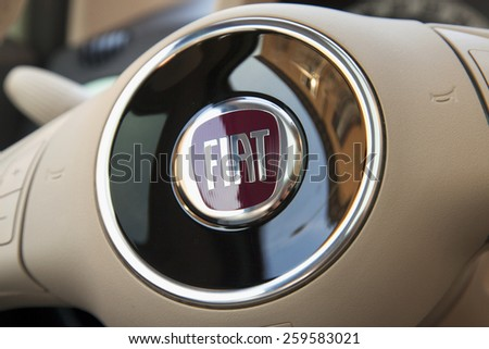 CASALE MONFERRATO, MARCH 10, 2015: Fiat symbol over steering wheel. Fiat is a subdivision group of great autumobiles group FCA. - stock photo