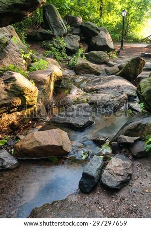 Cascade falls over rocks - stock photo