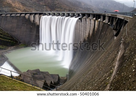 cascade from a hydroelectric plant - stock photo