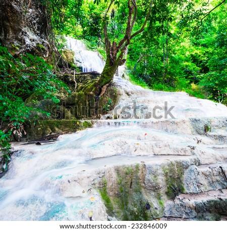 Cascade in deep forest at Erawan National Park - stock photo