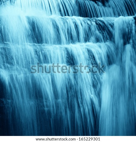 cascade in the forest in the night - stock photo