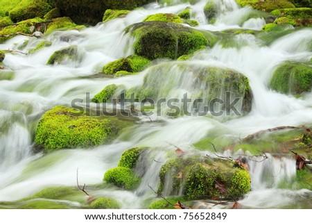 Cascade of the mountain river - stock photo