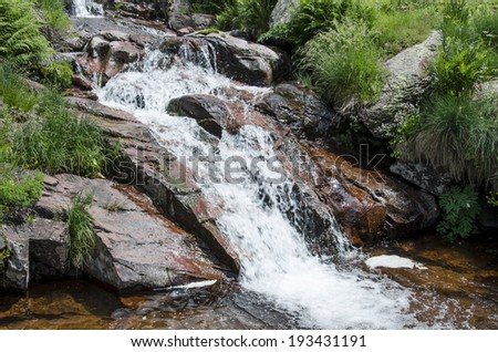 Cascade on the river - stock photo