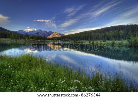 Cascade Ponds near Banff in Banff National Park Canada. These picturesque ponds are surrounded by the Rocky Mountains. - stock photo