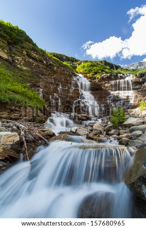 cascade water fall in Glacier National Park, MT - stock photo