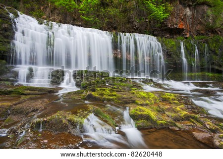 Cascades at the Sgwd Isaf Clun Gwyn waterfall in Brecon Beacons national park in Wales, in spring. - stock photo