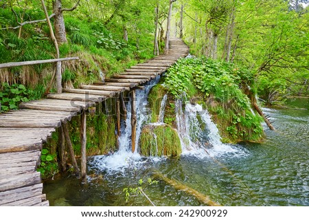 Cascades near the tourist path in Plitvice lakes national park  - stock photo