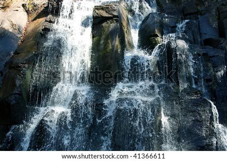 Cascades of fast, mountain falls - stock photo