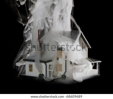 Cascades of smoke coming out of a burning house. - stock photo