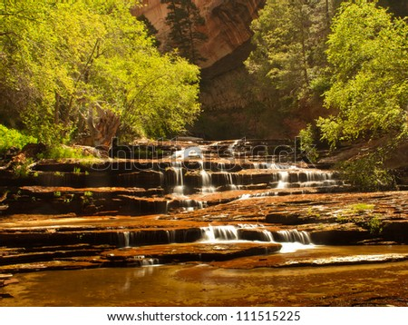 Cascades over redrock near the Subway, Zion National Park - stock photo