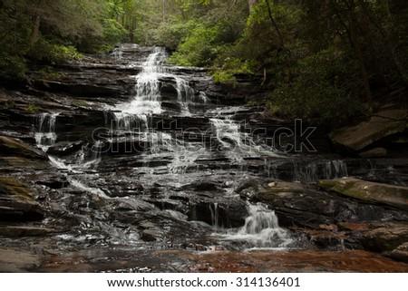 Cascading Mountain waterfall - stock photo
