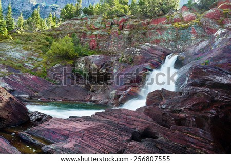 Cascading stream on Redrock Trail in east Glacier National Park, Montana - stock photo