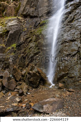 Cascading water behind rocks of Copper Creek Falls in north Idaho near the Canadian Border. - stock photo