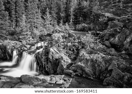 Cascading water falls on Redrock Trail in east Glacier National Park, Montana - stock photo