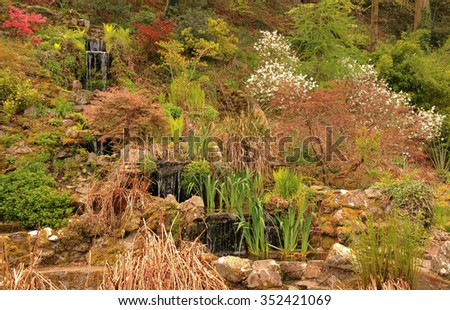 Cascading Water in the Simmons Park Public Gardens in the Town of Okehampton within Dartmoor National Park in the County of Devon, England, UK - stock photo
