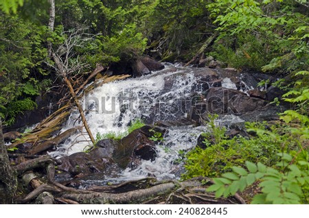 Cascading water over rocks north of Superior Lake - stock photo