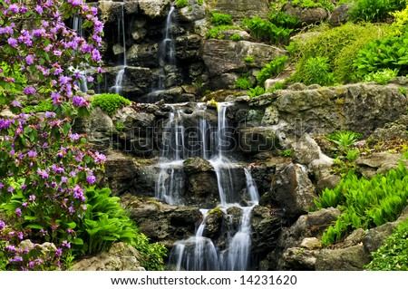 Cascading waterfall in japanese garden in springtime - stock photo